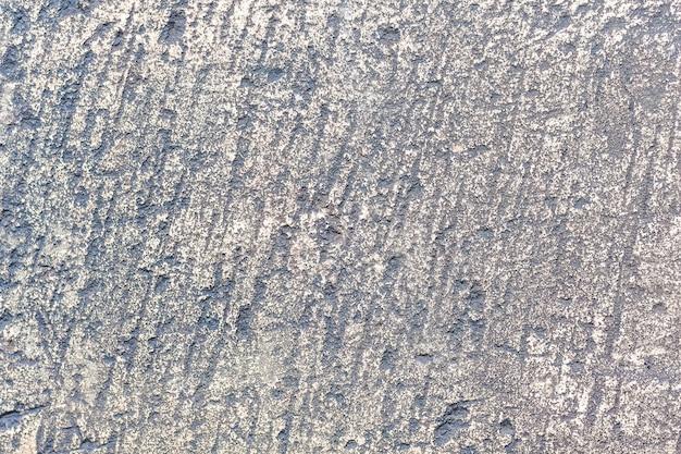 La texture d'une vieille pierre traitée grise