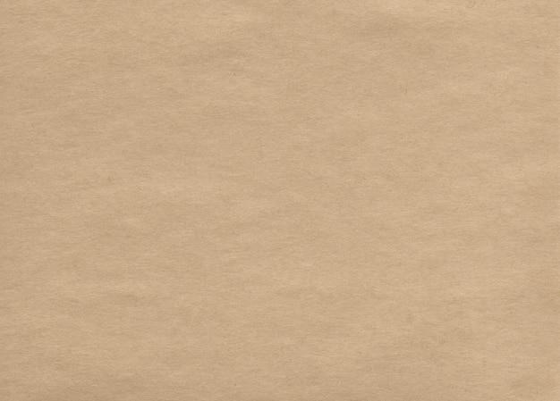 Texture vierge de papier kraft. abstrait naturel. surface rugueuse brune. papier carton.