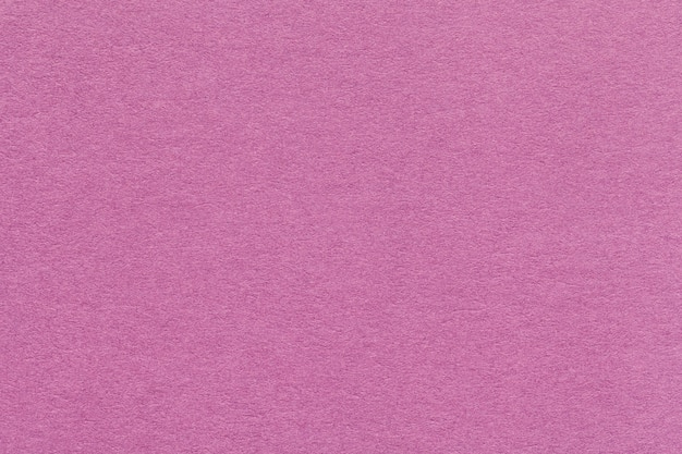 Texture de vieux closeup papier rose foncé