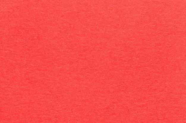 Texture de vieux closeup papier rouge vif.