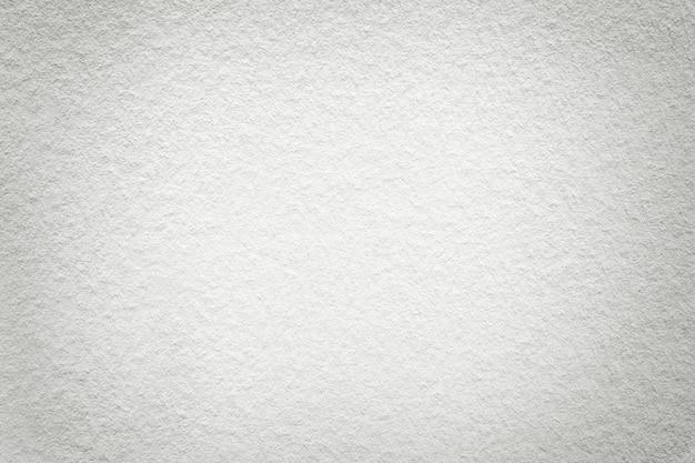 Texture de vieux fond de papier blanc léger, structure de carton dense,