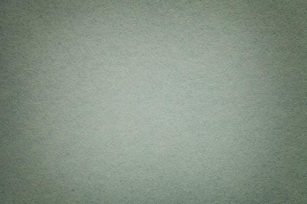 Texture de vieux fond de papier gris, gros plan. structure de carton dense.