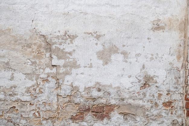 Texture de vieux mur de brique plâtrée rustique, fissuré