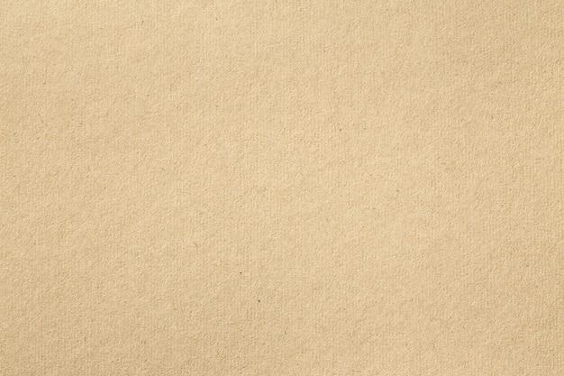 Texture de vieux papier brun pour le fond, gros plan de carton recyclé