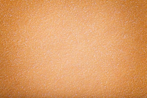 Texture de vieux papier orange, agrandi. structure en carton de corail dense.