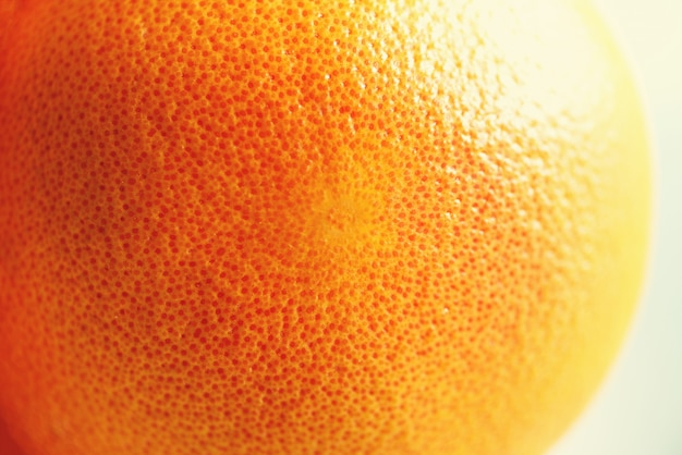 Texture de zeste d'orange vif, agrandi, espace copie. macro de fruits orange. agrumes