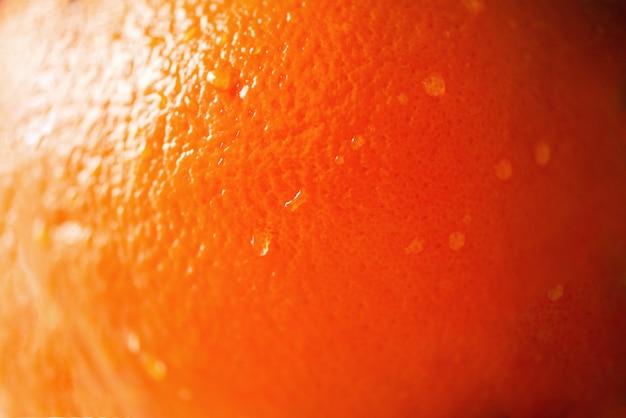 Texture de zeste d'orange vif, agrandi, espace copie.