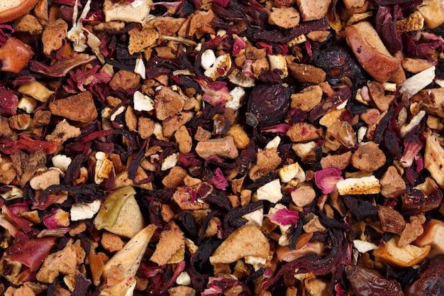 Thé mélange fruité de pétales d'hibiscus, zeste d'orange, églantier, pomme, arôme melon.