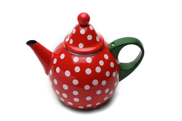 Théière rouge aux pois blancs pour infuser le thé