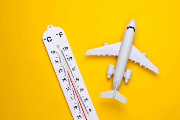 Thermomètre météo, avion sur jaune