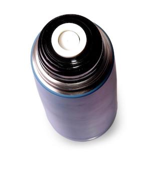 Thermos de voyage pour boissons chaudes sur surface blanche