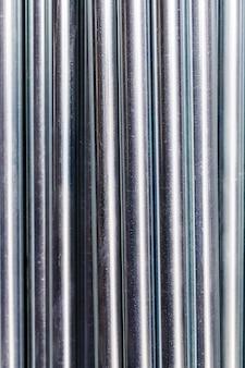 Tiges métalliques fond de ligne de tuyaux en acier