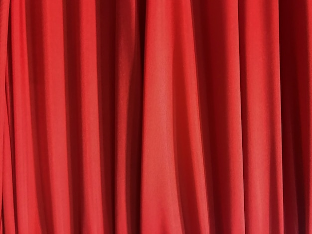 Tissage luxueux vertical, texture de tissu en tissu rouge, courbe de fond.