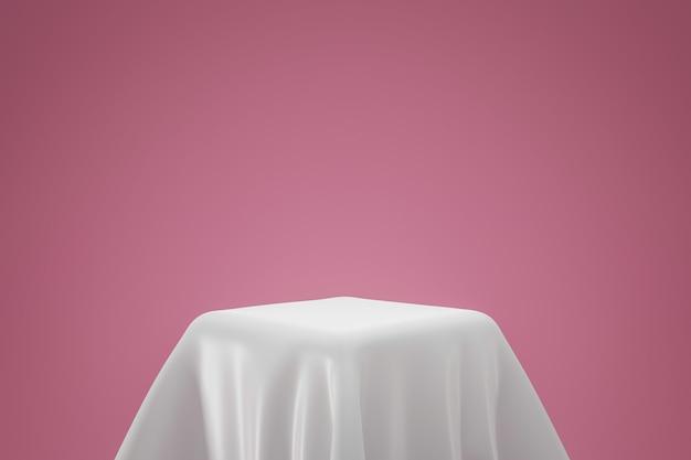 Tissu blanc sur piédestal