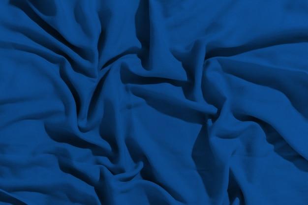 Tissu bleu classique froissé comme arrière-plan