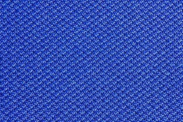 Tissu bleu synthétique, structure d'arrière-plan, vue macro en gros plan