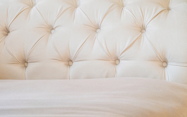 Tissu brun surface agrandi au fond texturé du canapé