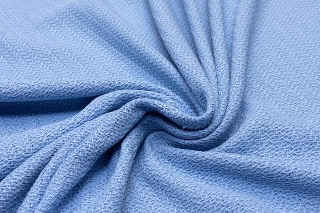 Tissu en coton bleu dans la disposition artistique
