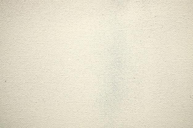 Tissu en coton crème sur fond.