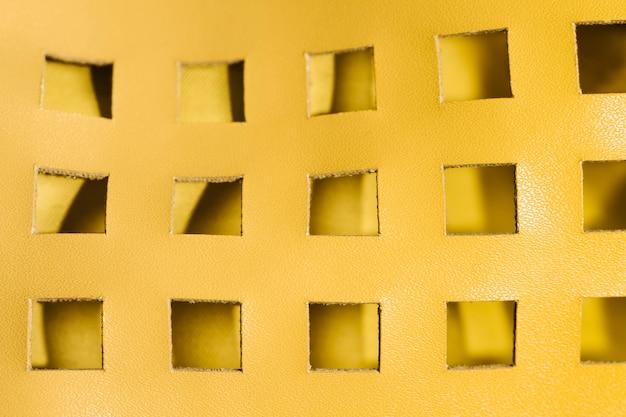 Tissu de cuir jaune abstrait gros plan