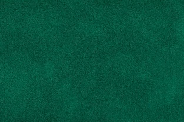 Tissu en daim vert foncé, texture velours,