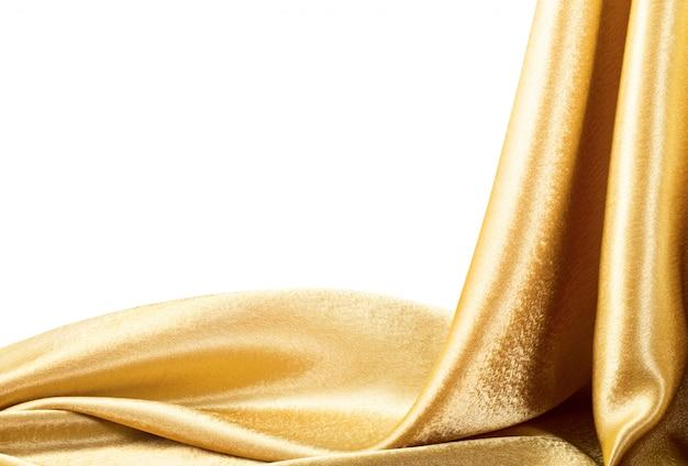 Tissu doré isolé sur blanc