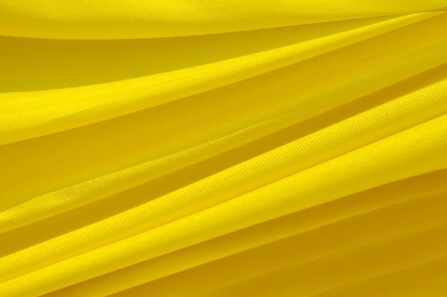 Tissu doré à motif de vagues
