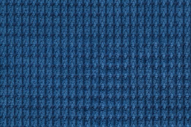 Tissu doux en laine bleu marine se bouchent.