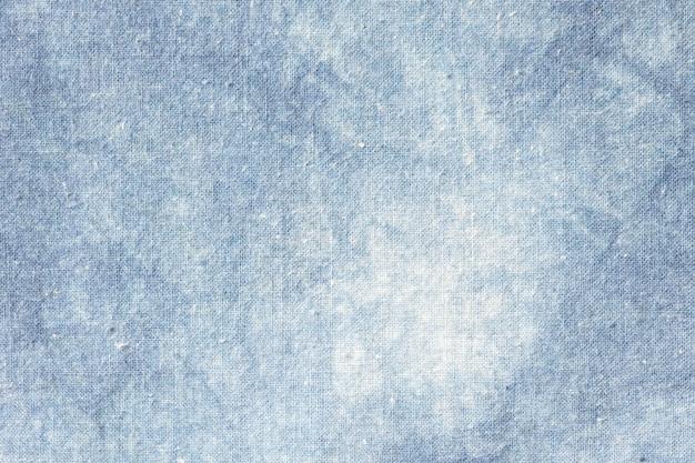 Le tissu est teinture indigo, tissu local, motif de teinture cravate indigo sur fond abstrait de tissu de coton.