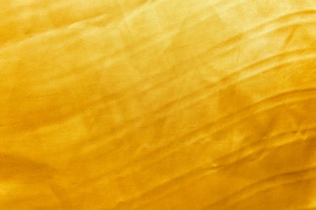 Tissu fond d'or ou texture et ombre de dégradés, oeuvre d'art de modèle de conception.