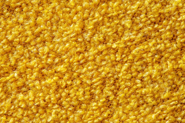 Tissu jaune moelleux de fond, gros plan macro