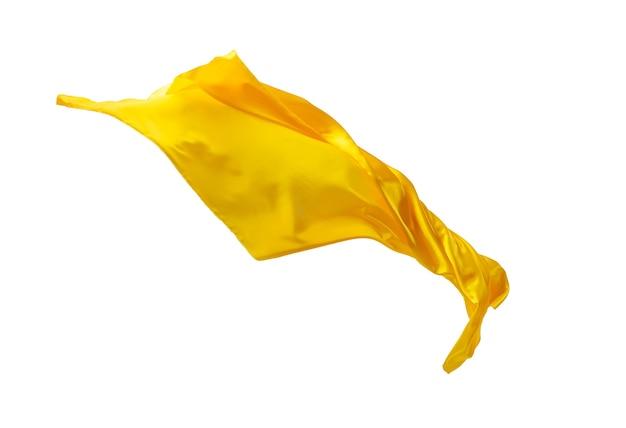 Tissu jaune transparent élégant et lisse séparé sur fond blanc.
