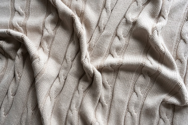 Tissu jersey texturé gris avec un motif