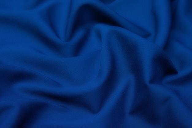 Tissu en laine. couleur noir et bleu. texture, arrière-plan, motif.