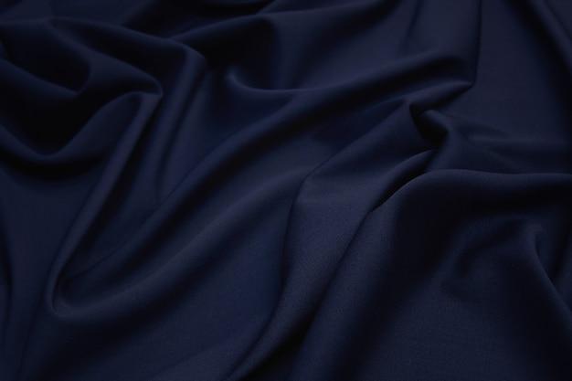 Tissu en laine luxueux en bleu foncé.