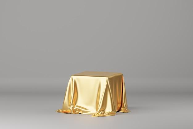 Tissu de luxe doré placé sur un podium ou un piédestal pour des produits ou de la publicité. rendu 3d. fond gris.