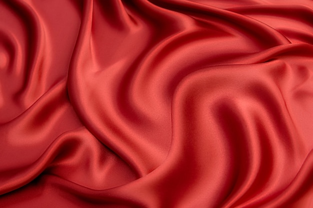 Tissu luxueux en viscose ou soie rouge. contexte et motif.