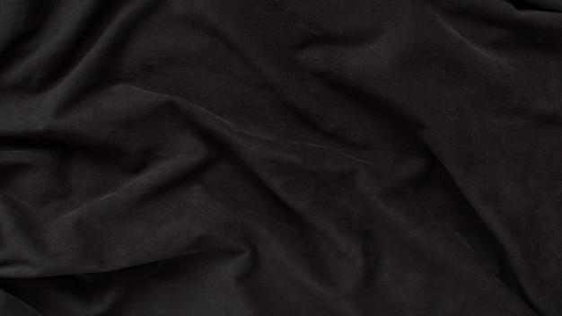 Tissu ondulé en daim marron foncé. texture, fond