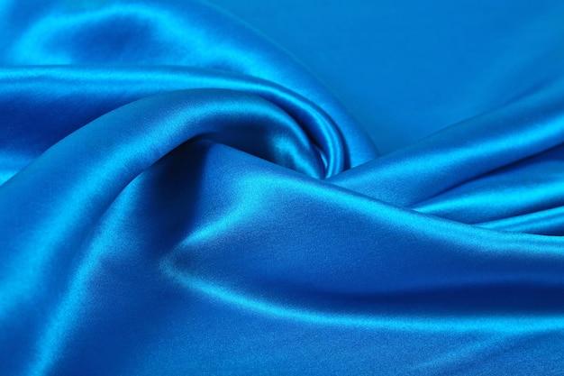 Tissu de satin bleu naturel comme texture de fond
