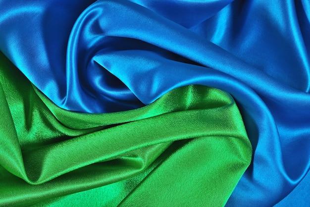 Tissu de satin bleu et vert naturel comme texture de fond