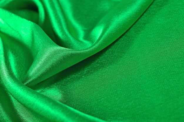 Tissu de satin vert naturel comme texture de fond
