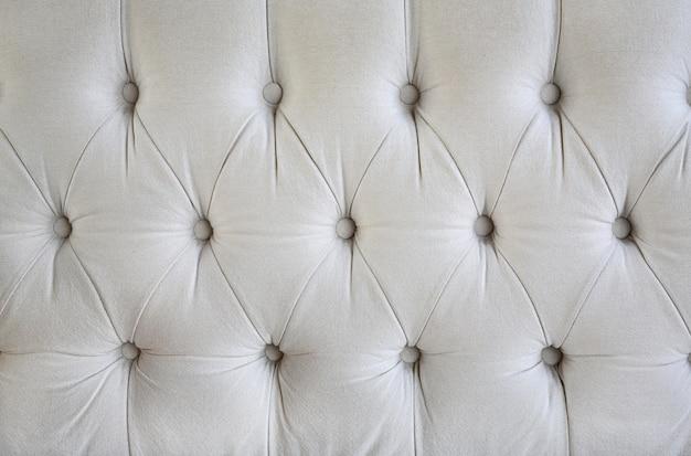 Tissu de style vintage avec texture de bouton de canapé