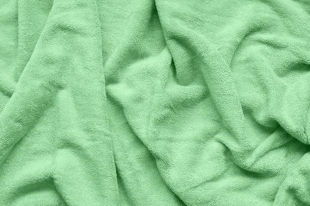 Tissu tendance de couleur menthe douce avec des vagues et des plis.