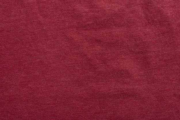 Tissu de toile de fond de texture de toile de fond textile. rouge.