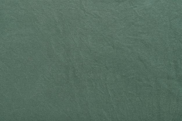 Tissu de toile de fond de texture de toile de fond textile. vert.