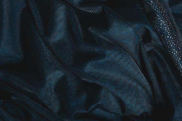 Tissu vert foncé avec des paillettes