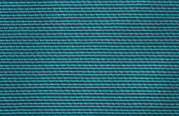 Tissu vert synthétique, structure d'arrière-plan, vue macro en gros plan