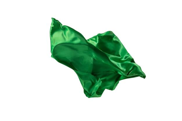 Tissu vert transparent élégant et lisse séparé sur fond blanc.