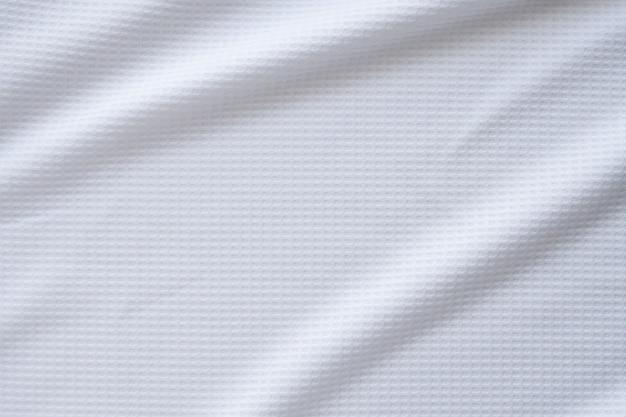 Tissu de vêtements de sport blanc maillot de football texture fond abstrait