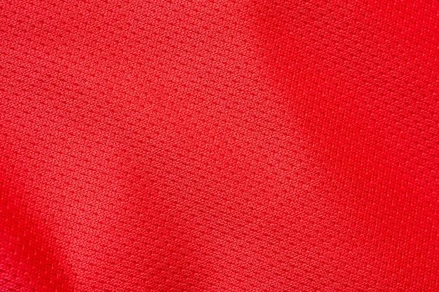 Tissu de vêtements de sport rouge maillot de football jersey texture background
